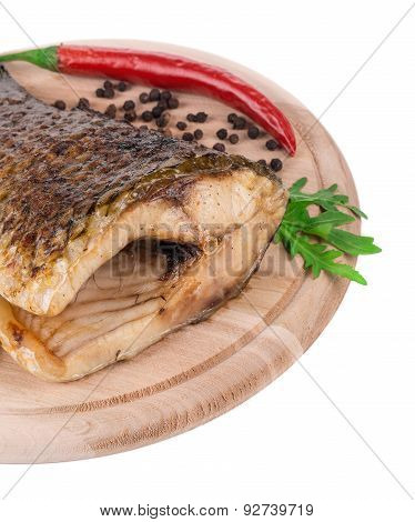 Fried carp tail with pepper and parsley.