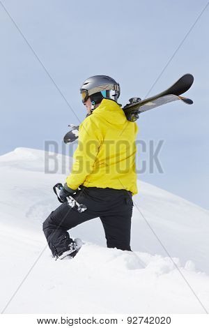 Man With Skis On Holiday In Mountains