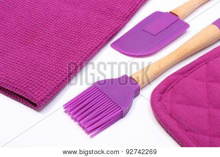 Purple Silicone Kitchen Accessories On White Background