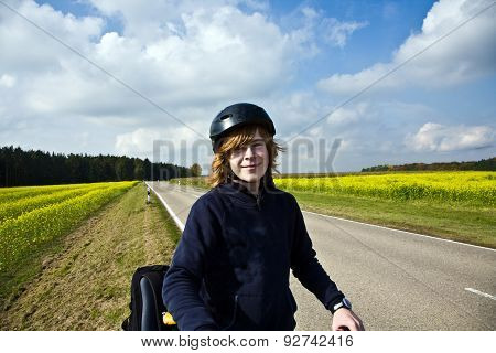 Young Boy On His Mountain Bike Is On A Bicycle Tour Along Beautiful Countryside
