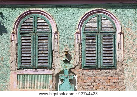 Green Old House Windows With Wood Curtains