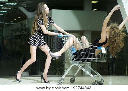 Two Beautiful Girls In Shopping Trolley