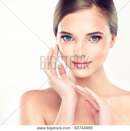 Beautiful Young Woman with Clean Fresh Skin close up