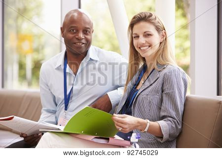 Portrait Of Two College Tutors Having Discussion Together