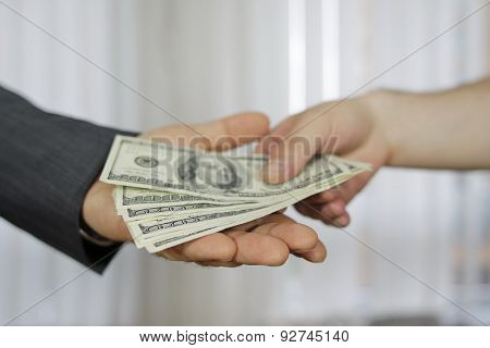 Corruption. Businessman in a suit takes a bribe