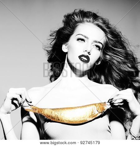 Alluring Young Woman With Golden Fish