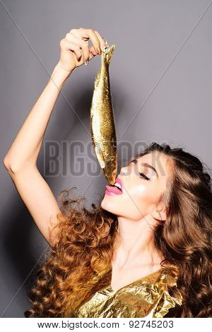 Pretty Young Girl With Golden Fish