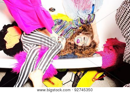 Showy Girl In Bath With Clothes