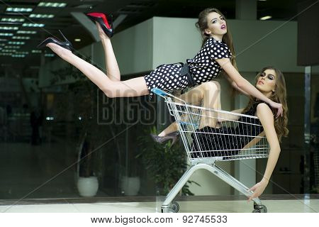 Two Winning Girls In Shopping Trolley