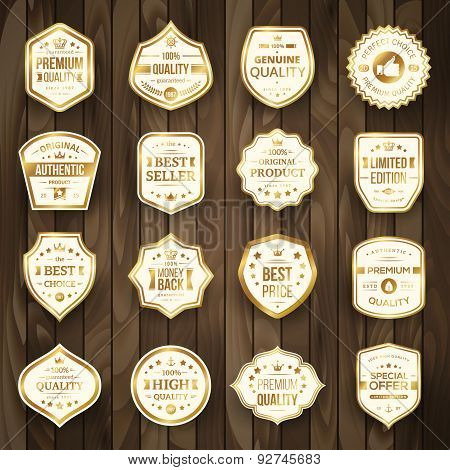Set of Retro Gold Premium Quality Badges and Labels on Wooden Background.
