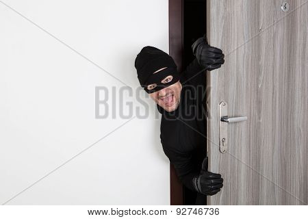 Burglar Breaking In An Apartment