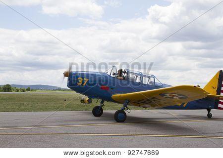 Pilot In Vintage Plane