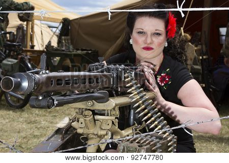 Pinup Behind Machine Gun