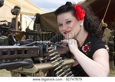 Pinup Leaning On Machine Gun