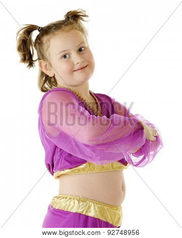 Close-up of a young genie in a purple and gold outfit, her arms crossed in front.  On a white background.