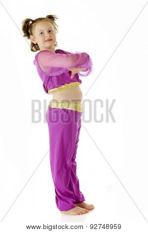 An elementary-aged genie standing, looking at viewer with arms crossed genie style.  On a white background.