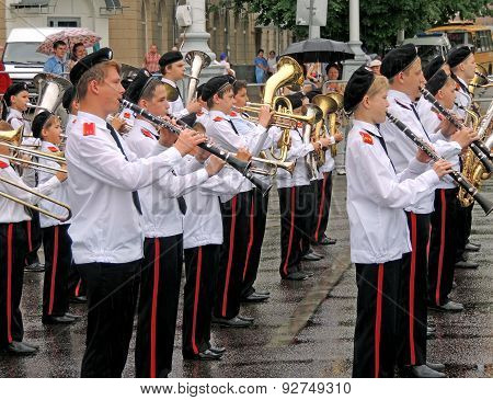 Brass Band Of Pupils In A Wet Day
