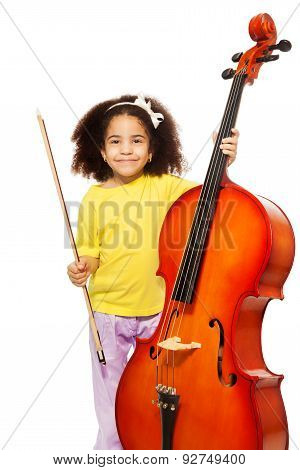 African girl holding cello with fiddlestick