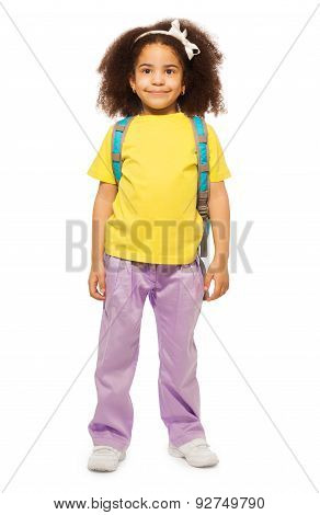 Full length view of smiling African girl with bag