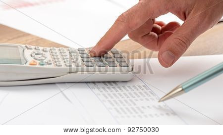Closeup Of Accountant Doing A Calculation