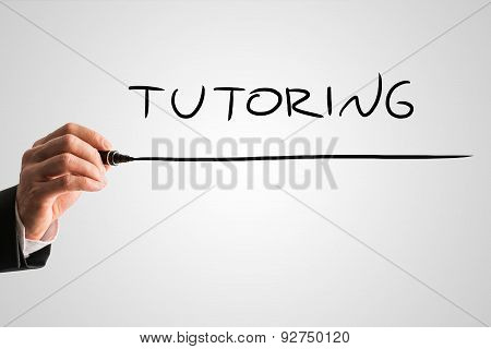 Businessman Hand Writing Underlined Tutoring Text
