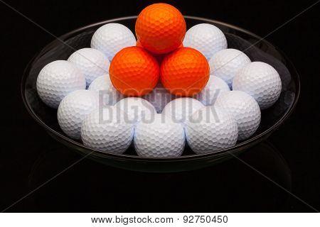 Black Ceramic Bowl Full Of Golf Balls