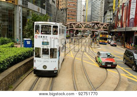 HONG KONG - JUNE 02, 2015: double-decker tram on street of HK. Hong Kong Tramways is a tram system in Hong Kong, being one of the earliest forms of public transport in the metropolis.