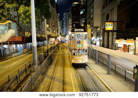 HONG KONG - JUNE 03, 2015: double-decker tram on street of HK. Hong Kong Tramways is a tram system in Hong Kong, being one of the earliest forms of public transport in the metropolis