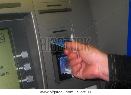 Putting Card In Money Machine