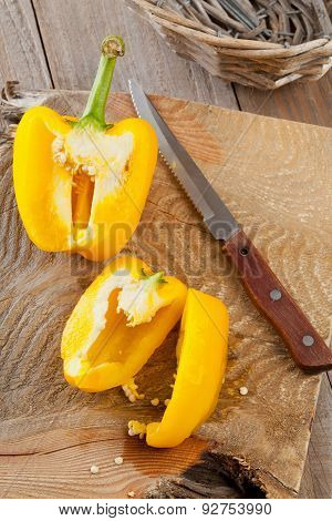 Preparing A Yellow Bell Pepper On Kitchen Table