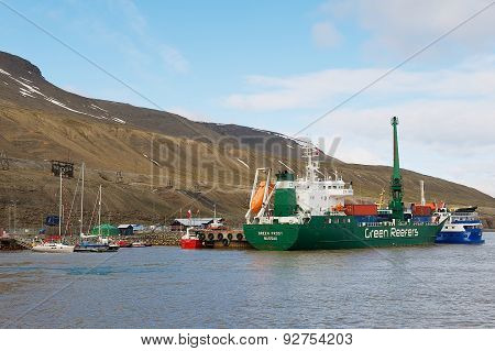 Cargo ship unloads at the harbor of Longyearbyen in Longyearbyen, Norway.