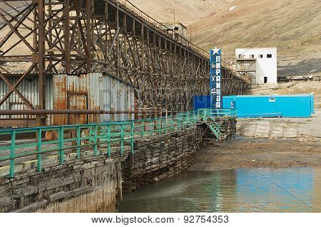 View to the pier of the abandoned Russian arctic settlement Pyramiden, Norway.