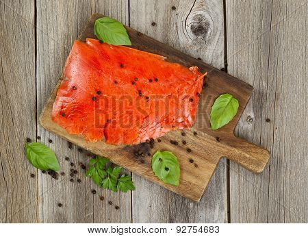 Cold Smoke Red Salmon Being Prepared On Wooden Server Board