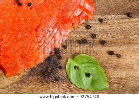 Cold Smoked Red Salmon On Server Board With Spices And Herb