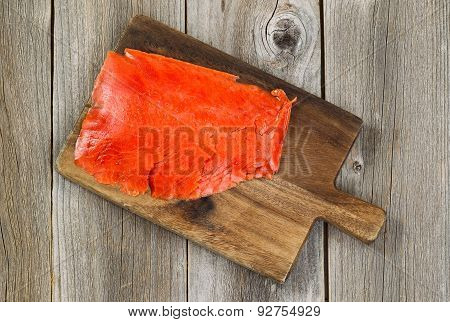 Cold Smoked Red Salmon On Wooden Server Board With Rustic Wood Background.