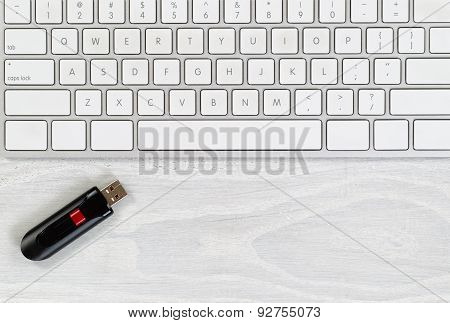 Desktop With Keyboard And Data Thumb Drive