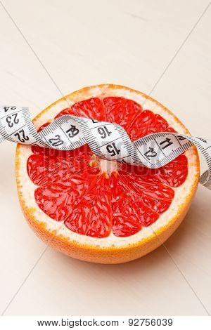Dieting. Grapefruit With Measuring Tape