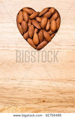 Heart Shaped Almonds On Wooden Surface Background
