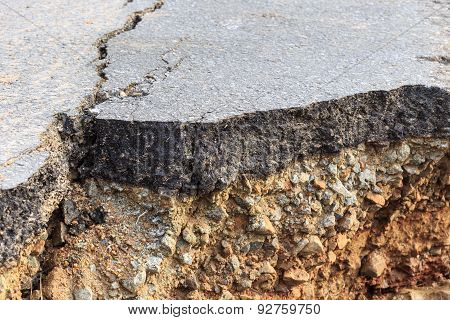 Damaged Asphalt. Layer Of Clay That Were Eroded