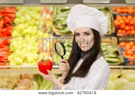 Happy Lady Chef Inspecting Vegetables with Magnifying Glass