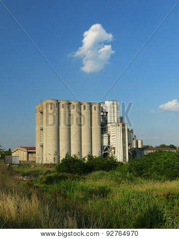 Old factory with silo tanks for corn