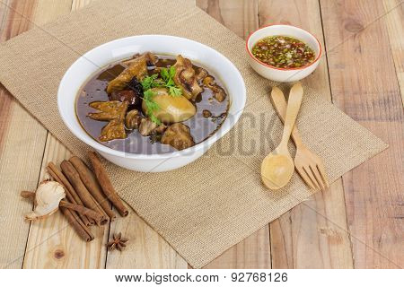 Pork And Egg Stewed In The Gravy On Wooden Table
