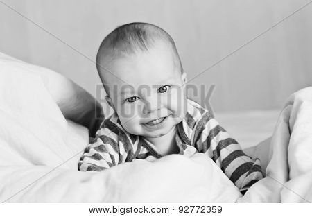 Happy Baby In Bed On His
