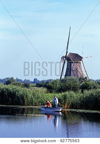 Fishermen and windmill, Kinderdijk.