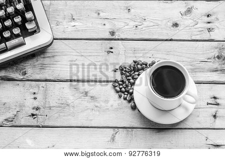 white coffee cup on B&W wooden background