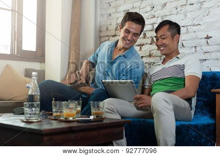Two Men Using Tablet Computer at Cafe, Friends Guys Sitting Coffee Shop