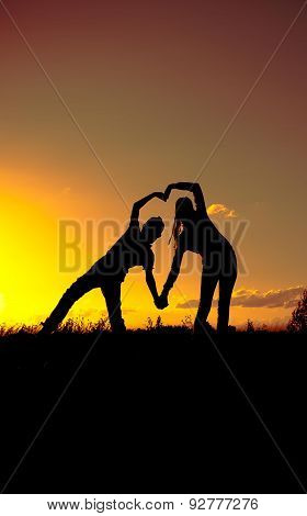 Two silhouette at sunset, a boy and a girl, a declaration of love