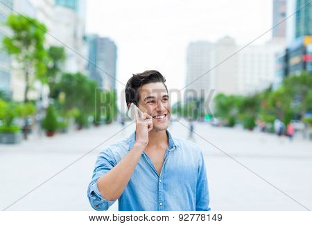 Handsome man cell phone call smile outdoor city street