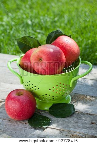 Fresh ripe red apples in colander