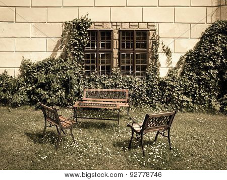 Benches and table in the castle garden